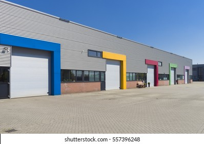 modern business units with colorful roller doors