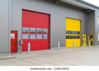 modern business units with red and yellow loading doors