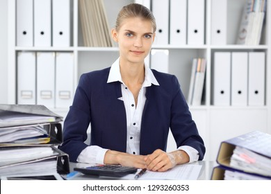 Modern business woman or confident female accountant in office. Student girl during exam preparing. Audit, tax service or education concept