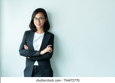 Modern business woman with her arms crossed standing on white background , copy space