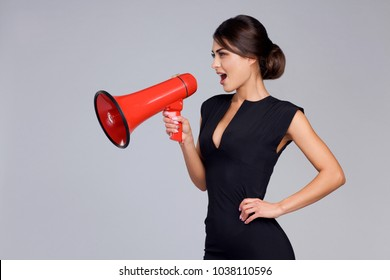 Modern business woman holds the loudspeaker in hand