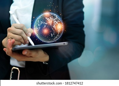 Modern business woman shows a world map of a new online trading network connecting big countries through cutting edge technology.
