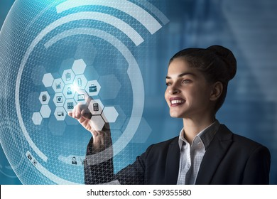 modern business woman using innovative technologies to manage her administrative work, using a digital hologram erp system