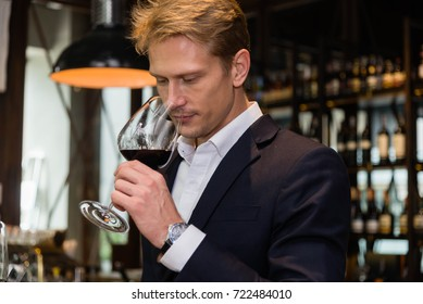 Modern businessman confident standing in suit relax time  with wine . young businessman confident in  suit, success deal business finance concept.