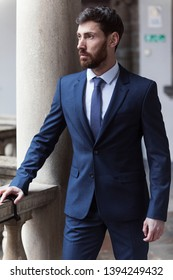 Modern businessman. Confident young man in full suit
