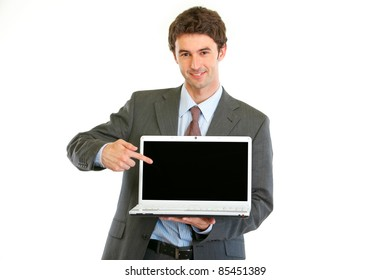 Modern businessman pointing on laptops blank screen isolated on white