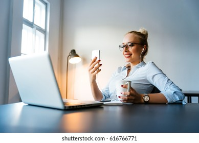 Modern bussines woman looking at her phone