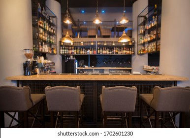 Modern cafe interior with wooden counter and chairs, no people, online bar, copy space