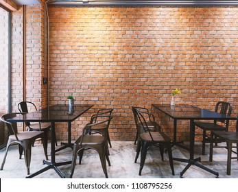 Modern cafe in loft style, black table set for coffee with brick wall