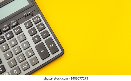 Modern calculator, Business and Finance accounting concept on yellow background with space for text.
