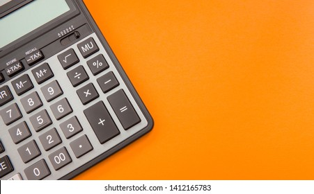 Modern calculator, Business and Finance accounting concept on orange background with space for text.