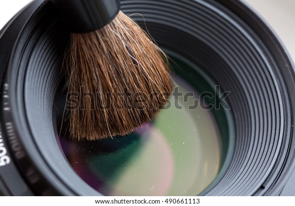 Modern camera Lens cleaning with brush close up view