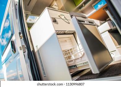Modern Camper Van 12V Refrigerator. RVing and Food Storage Theme.