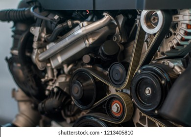 Modern car clean look engine with timing and serpentine belts