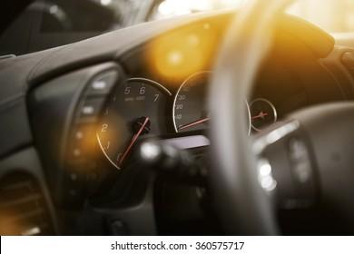 Modern Car Dashboard. Car Driving. Vehicle Steering Wheel and Dashboard.