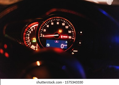 Modern car dashboard with speedometer, rpm meter and indicators
