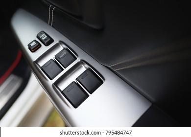 Modern car door panel control.Car door interior arm rest with window control panel.selective focus.
