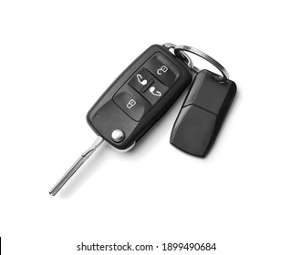 Modern car flip key with trinket isolated on white, top view