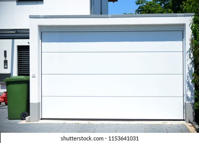 Modern Car Garage with automatic Door in Front of a Residential Building