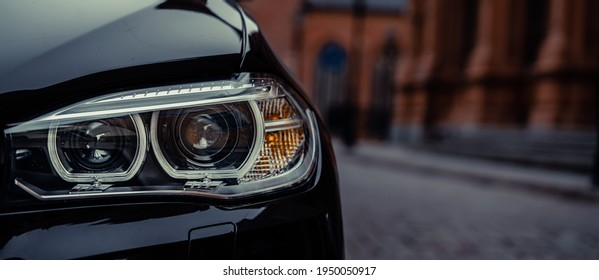 Modern car headlight close up photo
