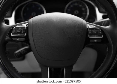 Modern car illuminated dashboard and steering wheel