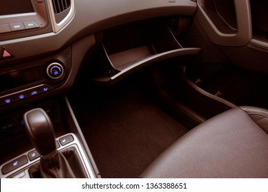 Modern Car Interior. Automatic Transmission, Gearbox Or Gear Level With Indicators And Control Buttons and Glove Compartment In Vehicle Interior.