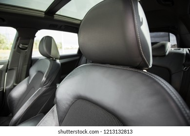 modern car interior with black leather seats