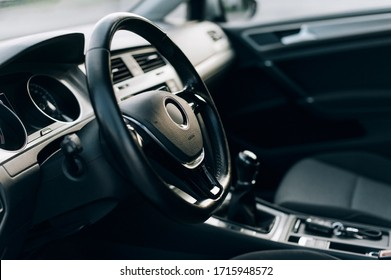 Modern car interior, black-gray combined saloon, aluminum, control parts, leather steering wheel