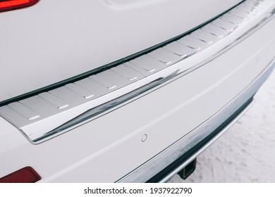 Modern  car interior, chrome trim on the rear bumper.