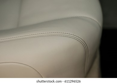 Modern car interior detail. Leather seat with stich.