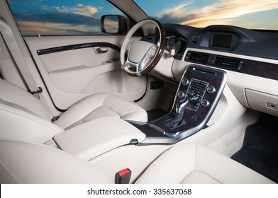 Modern car interior with sunset in the windows