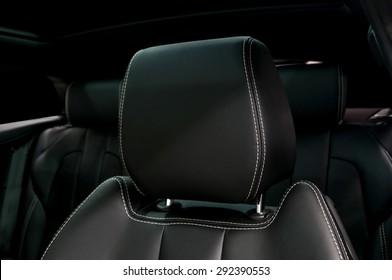 Modern car leather headrest. Interior detail.