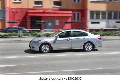 modern car moves on city street