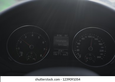 A Modern Car odometer Cluster with LCD Multifunction Display. Meter at constant speed show the fuel consumption efficiency
