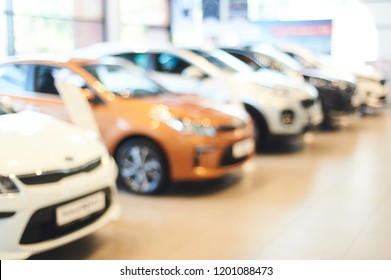 modern car showroom. blurred automobile hoods. not in focus background. copy space