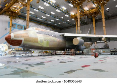 Modern cargo aircraft in the hangar during the heavy maintenance and painting