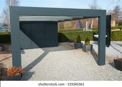 Modern carport car garage parking made from black metal and glass