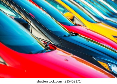 Modern Cars Stock Closeup. Colorful Cars Waiting For New Owners. Car Sales Industry.