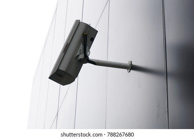 Modern cctv camera attach to the wall. Concept of surveillance and monitoring
