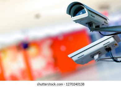 Modern CCTV camera on a wall. Concept of surveillance and monitoring.