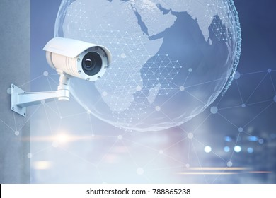 Modern CCTV camera on a wall. A blurred background with a night cityscape and Earth in the sky. Toned image double exposure mock up Elements of this image furnished by NASA