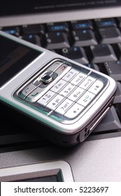 Modern cellphone on laptop