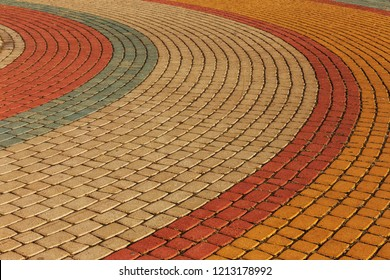 Modern cement multi-colored paving slabs. The background of a beautiful pedestrian walkway from modern fashionable paving tiles as a staged background for a perspective design