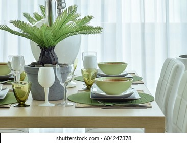 modern ceramic tableware in green color scheme setting on wooden dining table & Contemporary Table Setting Stock Photos Images \u0026 Photography ...