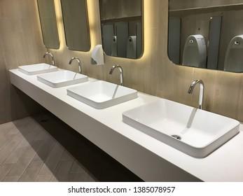 modern ceramic wash basin in toilet interior