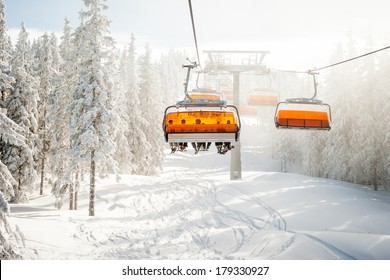 Modern chair ski lift in ski resort in Austria.