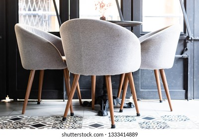 Modern chairs with table in coffee shop, bar, and cafe.