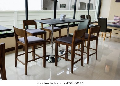 modern chairs and table in restaurant
