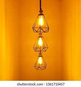 Modern chandelier hanging under ceiling