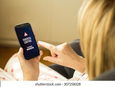 modern child protection concept: mature woman with 3d generated touchscreen smartphone with parental control on the screen. Screen graphics are made up.